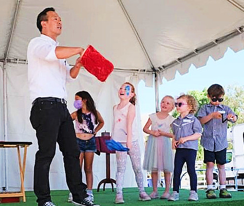 Alex Huang welcomes the crowd with magic and laughter at the 63rd Annual Portuguese Bend National Horse Show.