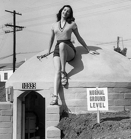 Mary Lou Miner sits on top of the bomb shelter