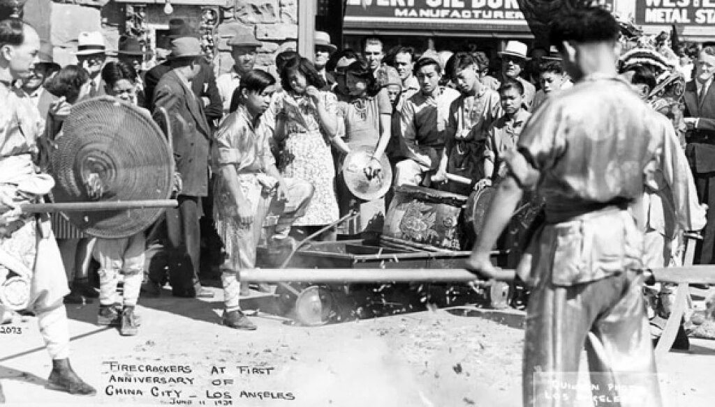 Firecrackers explode at the first anniversary of China City, on June 11, 1939.